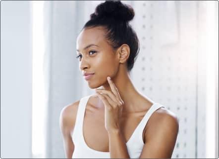 Woman admiring herself in the mirror