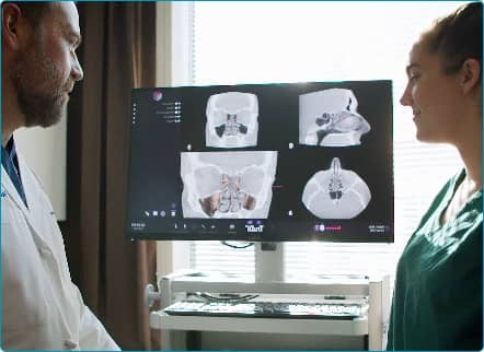 E N T doctor and nurse reviewing x-rays of nose